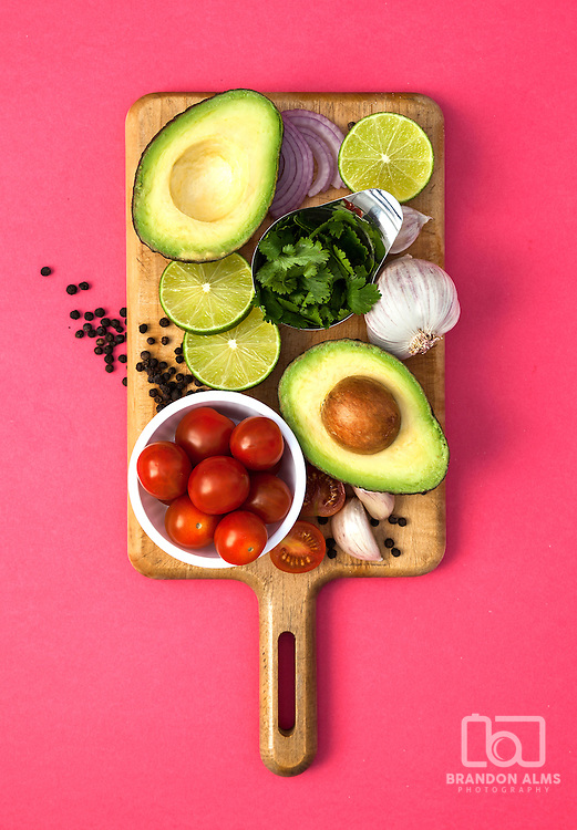 A styled food photograph consisting of the ingredients for guacamole. Photo by Brandon Alms Photography