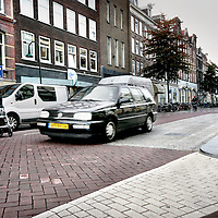 Nederland, Amsterdam , 20 oktober 2009..Gevaarlijke verkeerssituatie vanwege regelmatige snelheidsovertreding in  30 km zone bij gerenoveerde gedeelte Spaarndammerstraat..Dangerous traffic conditions due to regular speed violation in 30 km zone at renovated part of the Spaarndammerstraat, Amsterdam.