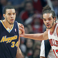 26 March 2012: Chicago Bulls center Joakim Noah (13) defends on Denver Nuggets center JaValee McGee (34) during the Denver Nuggets 108-91 victory over the Chicago Bulls at the United Center, Chicago, Illinois, USA. NOTE TO USER: User expressly acknowledges and agrees that, by downloading and or using this photograph, User is consenting to the terms and conditions of the Getty Images License Agreement. Mandatory Credit: 2012 NBAE (Photo by Chris Elise/NBAE via Getty Images)