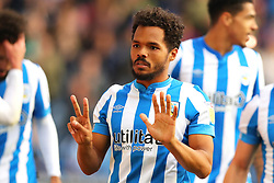 Huddersfield Town's Duane Holmes (centre) celebrates scoring his side's second goal during the Sky Bet Championship match at the John Smith's Stadium, Huddersfield. Picture date: Saturday October 16, 2021.
