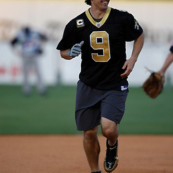 Apr 28, 2010; Metairie, LA, USA; Drew Brees (9) runs the bases after hitting a home run during the Heath Evans Foundation charity softball game featuring teammates of the Super Bowl XLIV Champion New Orleans Saints at Zephyrs Field.  Mandatory Credit: Derick E. Hingle-US-PRESSWIRE.