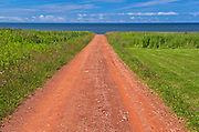 Country road of red sandstone <br />Waterford<br />Prince Edward Island<br />Canada