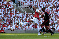 Photo: Daniel Hambury.<br />Arsenal v Ajax. Dennis Bergkamp Testimonial. 22/07/2006.<br />Arsenal's Thierry Henry scores to make it 1-1.