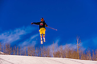 Skier jumping, Snowmass Terrain Park, Snowmass/Aspen ski resort, Snowmass Village, Colorado USA.