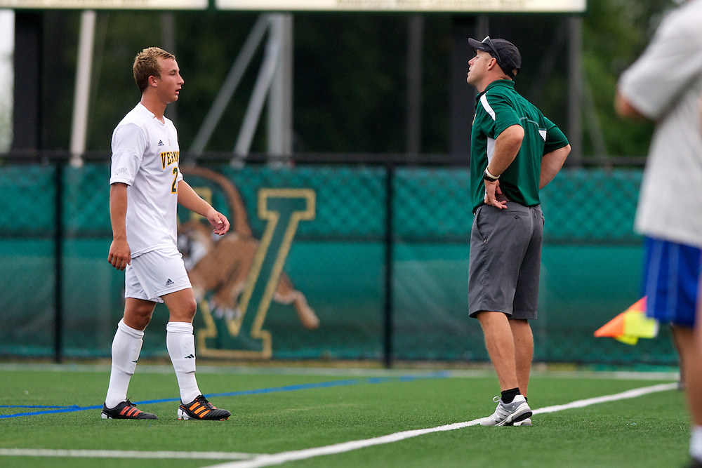Catamounts midfielder Danny Childs (21) talks with Catamounts head coach Jesse Cormier during the men's soccer game between the Central Connecticut State University Blue Devils and the Vermont Catamounts at Virtue Field on Friday afternoon September 7, 2012 in Burlington, Vermont.