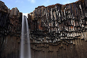 The rather frozen Svartifoss waterfall that is surrounded by basalt columns, in the heart of the Skaftafell National Park in south-eastern Iceland