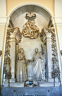 Picture and image of the stone sculpture of the Podesta family tomb in the Borgeois Realistic style by  D Carli 1892. Section A, no 39, The monumental tombs of the Staglieno Monumental Cemetery, Genoa, Italy .<br /> <br /> Visit our ITALY PHOTO COLLECTION for more   photos of Italy to download or buy as prints https://funkystock.photoshelter.com/gallery-collection/2b-Pictures-Images-of-Italy-Photos-of-Italian-Historic-Landmark-Sites/C0000qxA2zGFjd_k<br /> If you prefer to buy from our ALAMY PHOTO LIBRARY  Collection visit : https://www.alamy.com/portfolio/paul-williams-funkystock/camposanto-di-staglieno-cemetery-genoa.html
