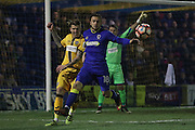 AFC Wimbledon midfielder Dean Parrett (18) and Sutton United Dean Beckwith (4) during the The FA Cup third round replay match between AFC Wimbledon and Sutton United at the Cherry Red Records Stadium, Kingston, England on 17 January 2017. Photo by Stuart Butcher.