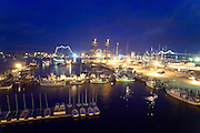 USA, Newport, RI 2004 - Wide angle overview at dusk of harbor with state fishing piers harbor and tallships during the 2004 tallships festival.