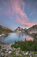 Wispy clouds over Sawtooth Lake and Mount Regan are illuminated by the setting sun. Sawtooth Mountains Wilderness Idaho