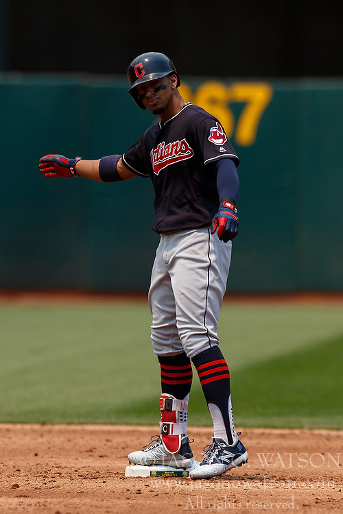 OAKLAND, CA - JULY 01:  Francisco Lindor #12 of the Cleveland Indians celebrates at second base after hitting a double against the Oakland Athletics during the third inning at the Oakland Coliseum on July 1, 2018 in Oakland, California. The Cleveland Indians defeated the Oakland Athletics 15-3. (Photo by Jason O. Watson/Getty Images) *** Local Caption *** Francisco Lindor