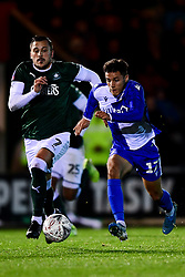 Tyler Smith of Bristol Rovers is challenged by Antoni Sarcevic of Plymouth Argyle - Mandatory by-line: Ryan Hiscott/JMP - 17/12/2019 - FOOTBALL - Home Park - Plymouth, England - Plymouth Argyle v Bristol Rovers - Emirates FA Cup second round replay