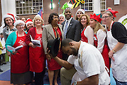 Retired Neurosurgeon and Republican presidential candidate Dr. Ben Carson and wife Candy pose for a photo with Christmas singers during a visit to the MUSC Children's Hospital December 22, 2015 in Charleston, South Carolina. Carson stopped by to listen to Christmas carols and greet the young patients.