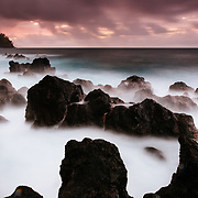 The waves of the Pacific Ocean crash onto the lava shores of Laupahoehoe State Park on the Big Island of Hawaii.