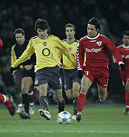Photo: Barry Bland.<br />FC Thun v Arsenal. UEFA Champions League. 22/11/2005. Nelson Ferreira and Cesc Fabregas.