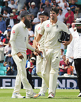Cricket - 2017 South Africa Tour of England - Third Test, Day Five<br /> <br /> Moeen Ali is given a stump by Alastair Cook after getting a hat trick of wickets (the first since 1938 for a spin bowler) during the afternoon session, at The Oval.<br /> <br /> COLORSPORT/ANDREW COWIE