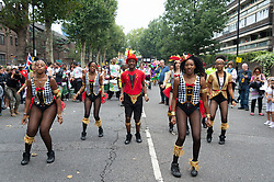 © Licensed to London News Pictures. 26/08/2018. London, UK.  Revellers and performers enjoy the first day of Notting Hill Carnival in west London. It is second largest street festival in the world after the Rio Carnival in Brazil, attracting over 1 million people. Photo credit: Ray Tang/LNP