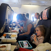 PARIS, FRANCE - NOVEMBER 03:  A mother and daughter during meal time on a flight from Paris to New York. Paris, France. 3rd November 2017. Photo by Tim Clayton/Corbis via Getty Images)