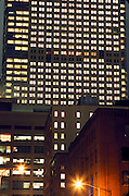 nocturnal office high rise behind old warehouse building, New York City, Manhattan Downtown West side from Canal street