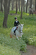 Young girl riding a horse in Ibiza, Spain