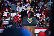 U.S. President Donald Trump speaks during a 'Make America Great Again' rally in Duluth, Minnesota, U.S., on Wednesday, Sept. 30, 2020.  Trump and Democratic nominee Joe Biden began their first debate on an acrimonious note and quickly made it personal, with each candidate interrupting and talking over each other. Photographer: Ben Brewer/Bloomberg