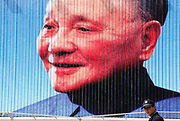 A policeman stands in front of a billboard featuring Deng Xiaoping, commonly recognized as the architect of China's economic reform,  in Shanghai, China on 27 April 2010. While economic reform has lifted millions out of poverty in China, there has been little to no political reform to address increasingly volatile problems such as corruption, state monopoly, land issues, while an increasing amount of funds have been channeled into beefing up domestic surveillance and public security.