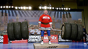 Ukranian Vasyl Virastuk lifts 898 pounds of Hummer tires and iron during the Hummer Deadlift event at the Arnold Fitness Weekend in Columbus, Ohio on Friday, March 5, 2004. The Hummer Deadlift was one of the five events of the 3rd Annual Arnold's Strongest Man Contest. <br /> ©ZP/Exclusivepix