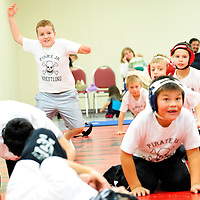 122012  Adron Gardner<br /> <br /> Ten-year-old Kaleb Hickson, left,  jumps up as fast as he can during exercises in wrestling practice at the Future Foundations center in Grants Thursday.