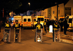 © Licensed to London News Pictures. 25/05/2013. Bristol, UK.   Riot Police arrested 20 people in Church Road, St George Bristol, holding in marchers after a disturbance following a March for our Troops from Kingswood to St George, reportedly collecting for Help for Heroes.  Some people barricaded themselves in a pub with tables and chairs.  Some local reports say the march involved the EDL but this has been denied by police.  25 May 2013..Photo credit : Simon Chapman/LNP