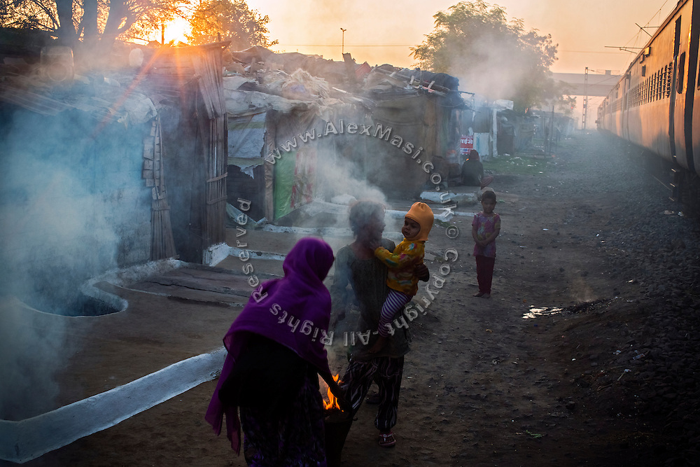 In the early morning, families are burning coal along the railway trucks running through New Arif Nagar, one of the contaminated colonies next to the abandoned Union Carbide (now DOW Chemical) industrial complex, in Bhopal, Madhya Pradesh, central India.