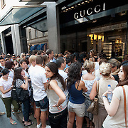 MILAN, ITALY - JULY 03:  Shoppers queue in front of the Gucci store in the fashion district of Milan on the first day of the Summer Sales on July 3, 2010 in Milan, Italy. Milan's summer sales start today. .***Agreed Fee's Apply To All Image Use***.Marco Secchi /Xianpix. tel +44 (0) 207 1939846. e-mail ms@msecchi.com .www.marcosecchi.com