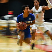 Chaminade guard Roman Young (1) drives to the basket during a semifinal of the PacWest Men's basketball championship in the Felix Event Center at Azusa Pacific University in Azusa, Calif. on Friday, March 6, 2020. (Mandatory Credit: Lily Smith-Sports Shooter Academy)
