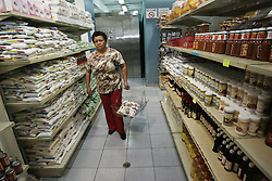 A woman shops at Mercal, a government sponsored subsidized food market, in the poor slum of Catia.  The Chavez government has built many of these markets throughout Venezuela.  It is one of the many social programs that Chavez saysaids the poor. Opponents claim that these programs  are not sustainable and are really aimed at gaining support for Chavez.