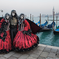 VENICE, ITALY - FEBRUARY 16:  A group of people dressed with carnival costume pose for pictures on February 16, 2012 in Venice, Italy.  The annual festival, which lasts nearly three weeks, will see the streets and canals of Venice filled with people wearing highly-decorative and imaginative carnival costumes and masks.  (Photo by Marco Secchi/Getty Images)