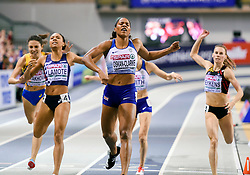 Great Britain's Shelayna Oskan-Clarke (centre) comes over the line to win the gold medal in the Women's 800m final during day three of the European Indoor Athletics Championships at the Emirates Arena, Glasgow.