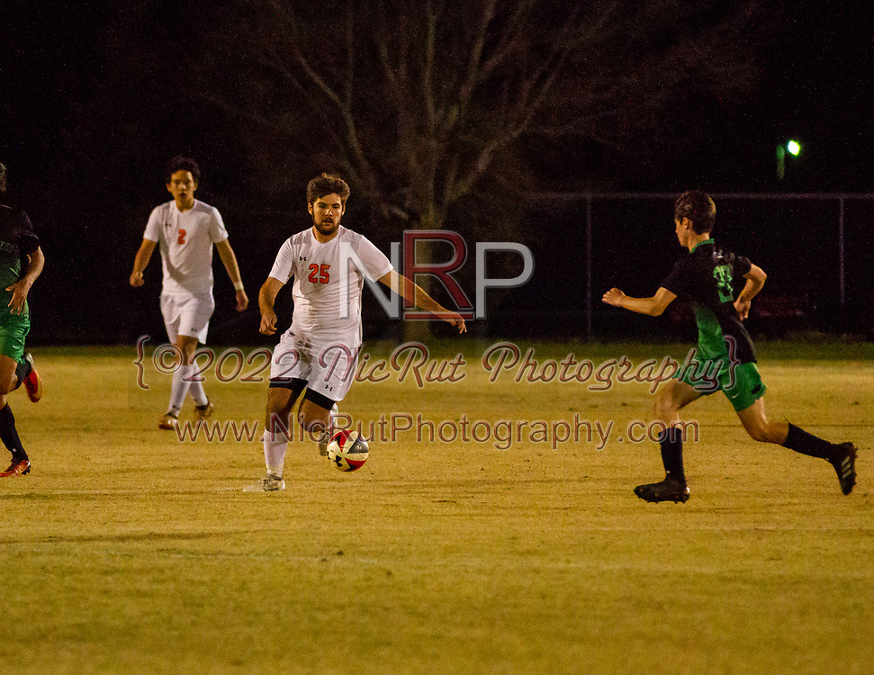 #25 Mason King looking for an open teammate during their game against Bishop McGuinness on April 24, 2018.