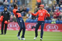 England's Jofra Archer (left) celebrates taking the wicket of Pakistan's Imam-ul-Haq duiring the Vitality IT20 match at Sophia Gardens, Cardiff.