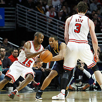 26 March 2012: Chicago Bulls point guard John Lucas III (15) drives past Denver Nuggets point guard forward Andre Miller (24) on a screen set by Chicago Bulls center Omer Asik (3) during the Denver Nuggets 108-91 victory over the Chicago Bulls at the United Center, Chicago, Illinois, USA. NOTE TO USER: User expressly acknowledges and agrees that, by downloading and or using this photograph, User is consenting to the terms and conditions of the Getty Images License Agreement. Mandatory Credit: 2012 NBAE (Photo by Chris Elise/NBAE via Getty Images)