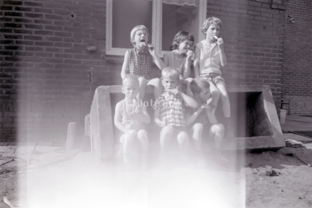 fading photo of children eating ice cream 1960s