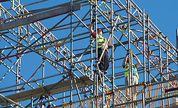 Scaffolders working on residential house under construction in East Lothian , Scotland, United Kingdom