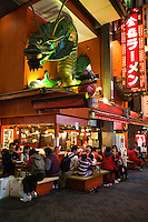 Dragon Noodles at Dotombori- a district famous for its historic theaters, its shops and restaurants and its many neon and mechanized signs, including candy manufacturer Glico giant electronic display of a runner crossing the finish line, giant blowfish and other dramatic kitsch.