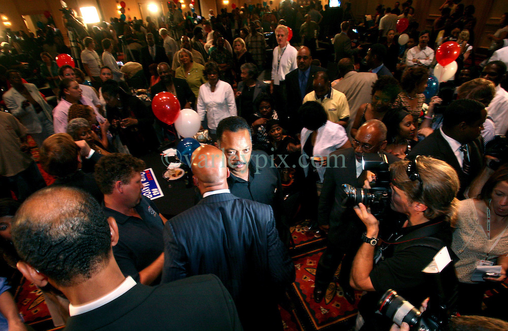 April 22nd, 2006. New Orleans, Louisiana. Voting day. Mayor Ray Nagin at his victory party in the Marriott hotel after securing a run off with opponent Mitch Landrieu. Nagin acknowledges the help of the Rev Jesse Jackson as he leaves the podium.<br /> Photo; Charlie Varley/varleypix.com