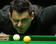 Ronnie O'Sullivan (Eng) has his one eye on the balls as he lines up a shot. Ronnie O'Sullivan v Liang Wenbo, 1st round match at the Dafabet Masters Snooker 2017, day 1 at Alexandra Palace in London on Sunday 15th January 2017.<br /> pic by John Patrick Fletcher, Andrew Orchard sports photography.