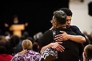 Mourners embrace during the funeral for Tony Robinson, Jr. at Madison East High School in Madison, Wisconsin, Saturday, March 14, 2015. Hundreds of people gathered on Saturday for the funeral of a 19-year-old man killed by a police officer in Wisconsin's capital on March 6, a shooting that prompted protests over law enforcement's treatment of minorities.  REUTERS/Ben Brewer (UNITED STATES)