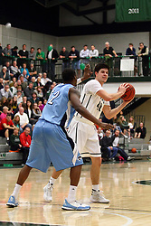 20 February 2016:  Will Nixon defends Alec Bausch(40) during an NCAA men's division 3 CCIW basketball game between the Elmhurst Bluejays and the Illinois Wesleyan Titans in Shirk Center, Bloomington IL