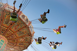 United States, Washington, Puyallup, people swinging on amusement park ride at annual Puyallup Fair