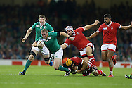Sean Cronin of Ireland breaks away from the tackle from Canada's Andrew Tiedemann. Rugby World Cup 2015 pool A match, Ireland v Canada at the Millennium Stadium in Cardiff, South Wales  on Saturday 19th September 2015.<br /> pic by  Andrew Orchard, Andrew Orchard sports photography.