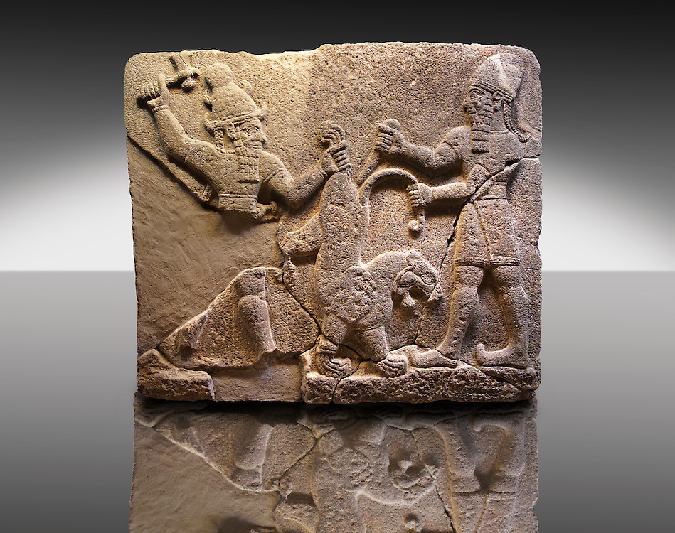 Picture & Image of  Neo-Hittite orthostat describing the legend of Gilgamesh from Karkamis,, Turkey. Museum of Anatolian Civilisations, Ankara.  To the left a bearded deity with a horned helmet is holding a lions back leg and is about to strike it with an axe. To the right a man is stabbing the lion with a dagger.