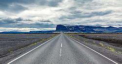 THEMENBILD - eine Strasse, im hintergrund ein Berg, aufgenommen am 18. Juni 2019 in Island // a road, in the background a mountain, Iceland on 2019/06/18. EXPA Pictures © 2019, PhotoCredit: EXPA/ Peter Rinderer