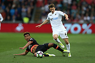 Tom Carroll of Swansea city is tackled by Everton's Mason Holgate (l). Premier league match, Swansea city v Everton at the Liberty Stadium in Swansea, South Wales on Saturday 6th May 2017.<br /> pic by  Andrew Orchard, Andrew Orchard sports photography.